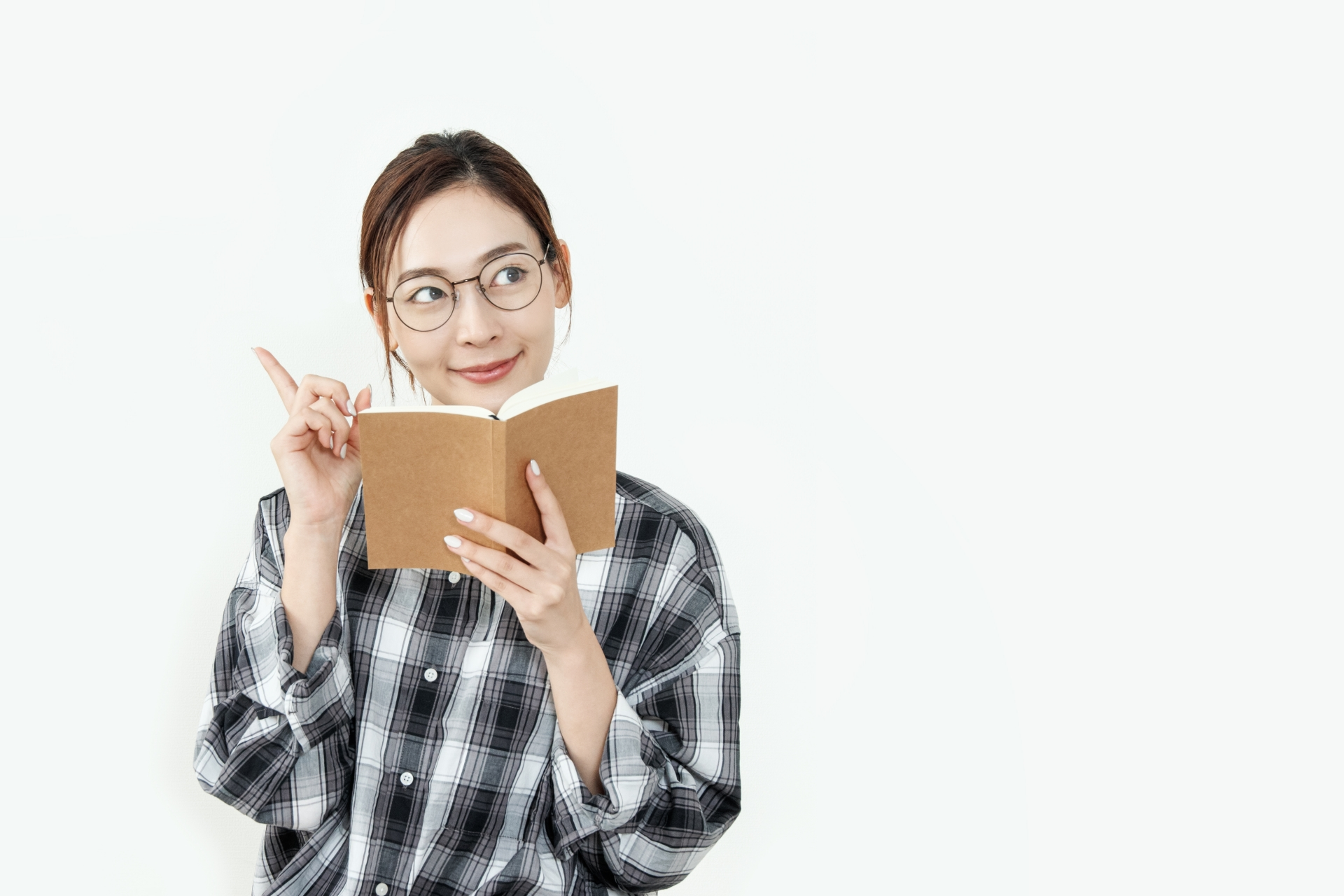 本をみて閃いた女性
